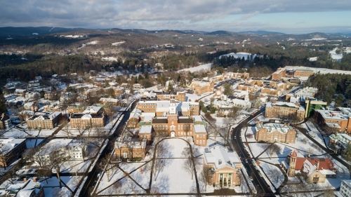 an aerial view of Baker Tower on a snowy day